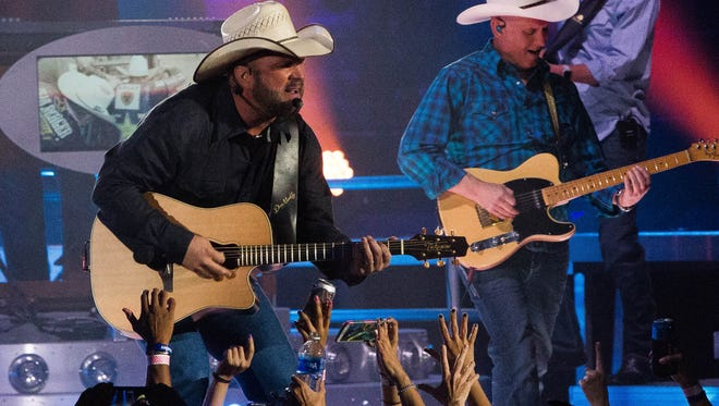 Fans of Country Music Star Garth Brooks reach out cheering as he performed, Friday, April 7, 2017 at the Pan American Center.