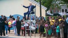 Former Vice President Joe Biden sits in the lifeguard