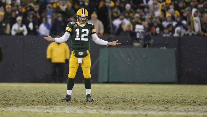 Green Bay Packers quarterback Aaron Rodgers reacts after a play in the third quarter during Sunday's game against the Detroit Lions at Lambeau Field.