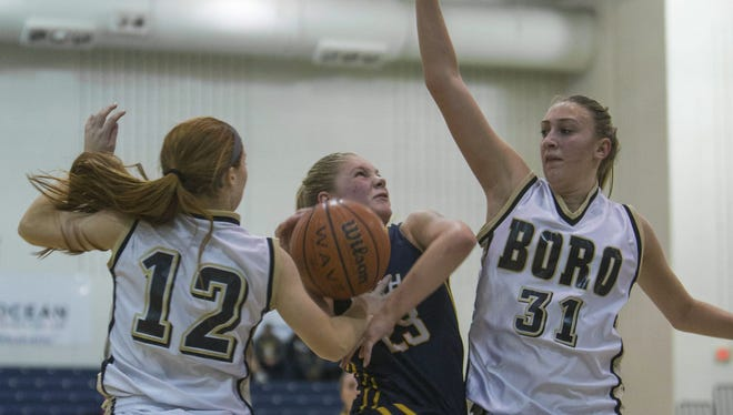 Toms River North's Jenna Paul goes up with a shot as she covered by Point Pleasant Boro's Carlie Ventrini and Ally Lassen. Toms River North Girls Basketball vs Point Pleasant Boro in WOBM Christmas Classic Final.   Peter Ackerman