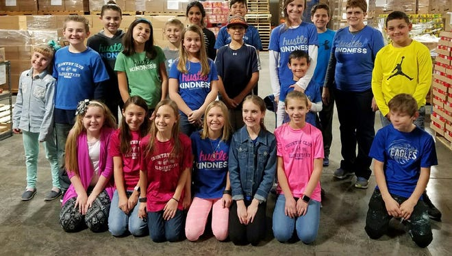 Members of the Country Club Elementary School Student Council and club sponsors Dena Leboeuf and Stephanie Smetak pose on Jan. 25 at ECHO Food Bank in Farmington.