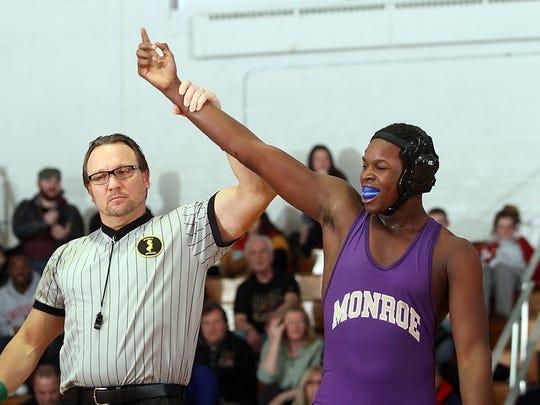 Kaylon Bradley of Monroe beats Christopher Cuevas of Edison in the 182lb match, Wednesday, January 14, 2015, in Edison, NJ.Jason Towlen/Staff Photographer