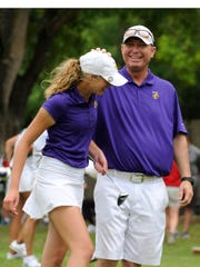 Wylie's Maddi Olson is congratulated by Wylie golf coach Mike Campbell after finishing the final round of the 2017 Class 4A UIL state golf tournament at Horseshoe Bay Resort's Slick Rock golf course. Olson won the individual state title by one shot with a two-round score of 146.