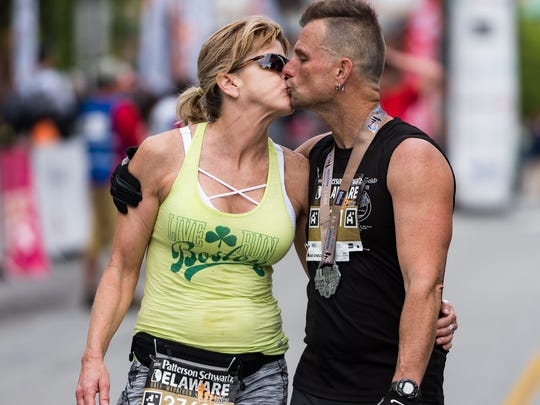 El Jones of Elkton and Mick Donnelly of Wilmington celebrate completing the Delaware Half-Marathon with a kiss.