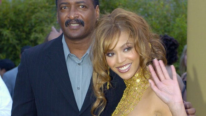 ORG XMIT: NYET470 ** CORRECTS SPELLING OF MATHEW ** FILE - In this Feb. 8, 2004 file photo, singer Beyonce Knowles arrives at the 46th Annual Grammy Awards with her father and manager Mathew Knowles in Los Angeles. (AP Photo/Mark J. Terrill, file)