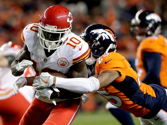 FILE - In a Sunday, Nov. 27, 2016 file photo, Kansas City Chiefs wide receiver Tyreek Hill (10) is tackled by Denver Broncos cornerback Chris Harris (25) during the first half of an NFL football game, in Denver. Spoiler is an unfamiliar role for Harris Jr., who get to see what it's like to play for nothing but pride on Jan. 1 when the Denver Broncos host the Oakland Raiders. (AP Photo/Jack Dempsey, File)
