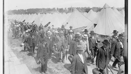 Veterans arrive at the tent city during the 50th anniversary of the battle of Gettysburg (Library of Congress)