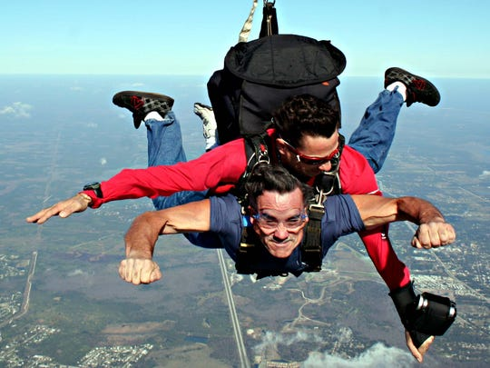 Chuck Reed is shown skydiving -- for the first time -- with Yuri Turci, a tandem instructor at Skydive Space Center in Titusville in this December 2008 photo.