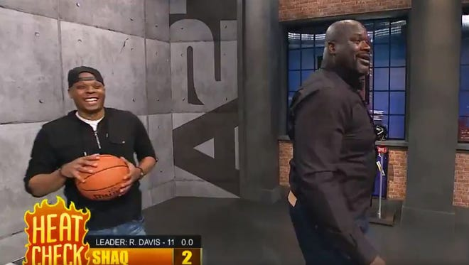 Bonzi Wells and Shaquille O'Neal laugh together following Shaq's shooting performance on KG's Area 21.