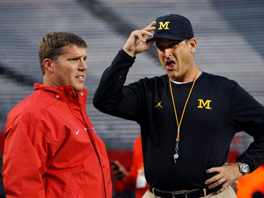 Rutgers head coach Chris Ash, left, and Michigan head