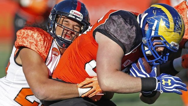 Former Ole Miss safety Cody Prewitt, left, makes a tackle for the South team in Saturday's Senior Bowl.