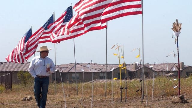 Edward Pulido of Ventura walks past a Chumash burial marker set near the groundbreaking ceremony for the veterans home in east Ventura in this 2007 file photo.