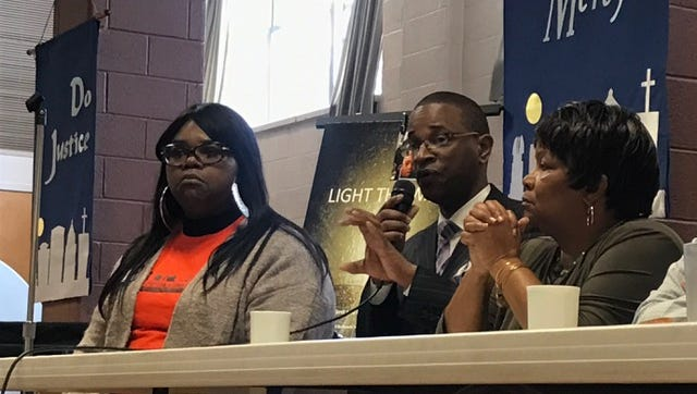 Kenneth Mohammed of the Nation of Islam, center, speaks at a panel discussion on gun violence, held by United Christian Leadership Ministry's Light the Way Committee Saturday.