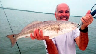 Brian Gomes used a live herring to catch his first redfish. He was fishing Estero Bay's Davis Key with Entice Charters Capt. Scott Theis.