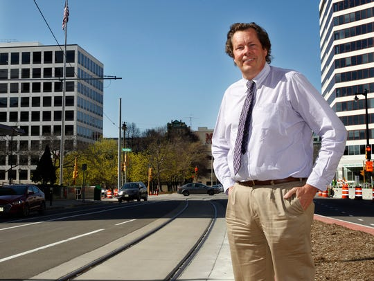 Dave Cory stands near the new streetcar tracks on Broadway