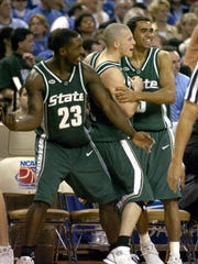 Kelvin Torbert, Drew Neitzel and Chris Hill celebrate Michigan State's win over Duke in the Sweet 16 on March 25, 2005.