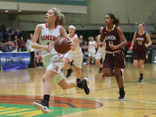 Somers' Jacqueline Penzo (1) heads up the court on