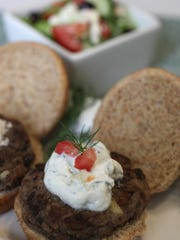 Open-faced Mediterranean sliders with feta sauce. Thursday, June 18, 2015.