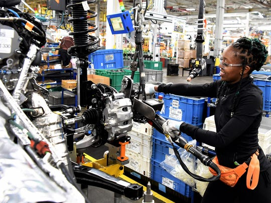 Ebony Atkins-Conner, Ford employee, installs the engine on the all-new 2020 Ford Explorer at Chicago Assembly Plant.