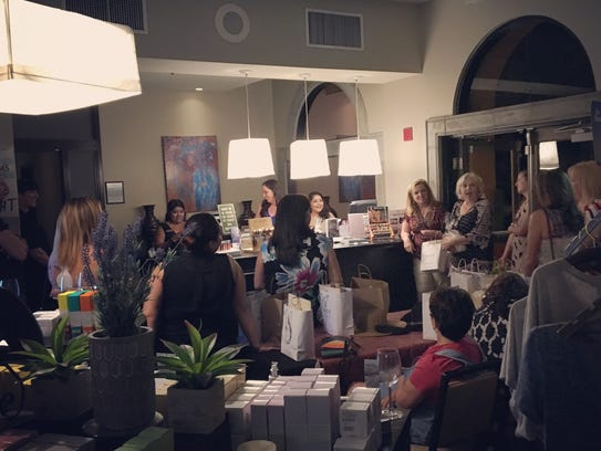 Guests gather for a raffle during a Spa Soiree at The