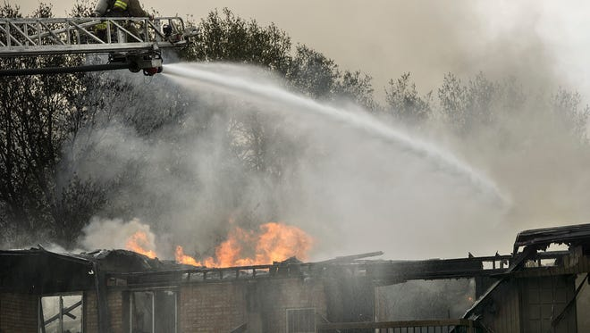 Five community fire departments pour massive amounts of water on the blaze. The fire spreads anyway.