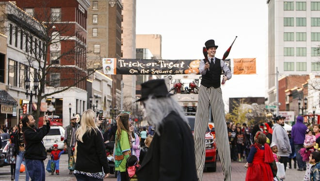 Performance artist and stilter Andrew D'Ascenzo, of Rochester, performs at Trick-or-Treat on the Square in downtown Lansing, Oct. 26, 2015. Hundreds of trick-or-treaters, young and old, gathered on Washington Square for the annual event.