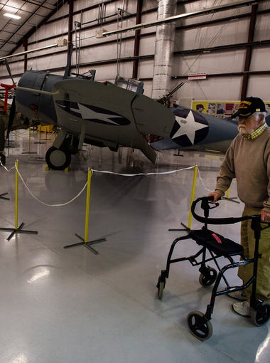World War II Navy Seabees veteran Norm Oliphant walks through one of the hangars displaying restored aircrafts on May 5, 2018, at the National Museum of World War II Aviation in Colorado Springs, Colorado.