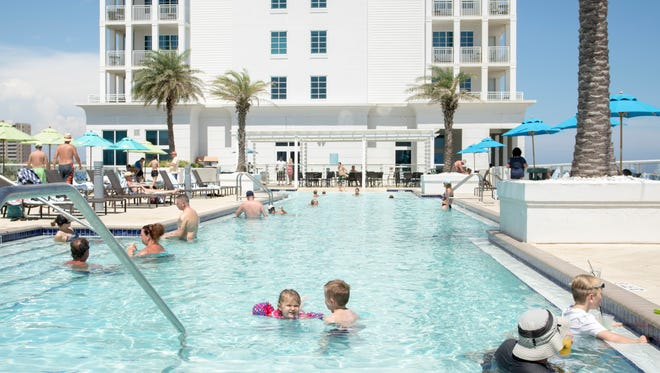 Guests enjoy the pool at the Margaritaville Hotel on Pensacola Beach, FL on Tuesday, July 5, 2016.   Visit Pensacola uses metrics to monitor the tourism economy and to better target its marketing.