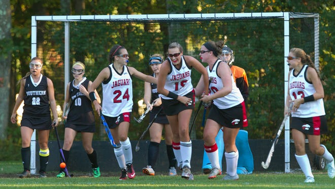 Jackson Memorial's Chloe Daum  (#24) celebrates with teammates after scoring her second goal of game on a feed from Amanda Miller. Southern Regional Field Hockey vs Jackson Memorial in Jackson, NJ on October 15, 2015