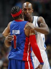 Detroit Pistons guard Allen Iverson, left, hugs Denver