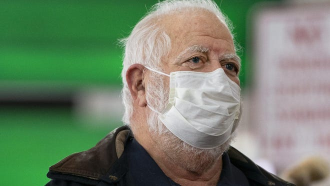 Arthur Damm, of West Palm Beach wore a medical mask on his flight from Boston to West Palm Beach. Damm said he has had pneumonia for the past 9 days and decided to wear the mask because his immume system was compromised and he did not want to get any illness lincluding the cororavirus on his way back to Palm Beach International Airport in West Palm Beach, Florida on March 2, 2020.