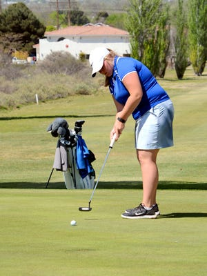 Carlsbad's Peyton Oliver putts on the second green Tuesday at Lake Carlsbad Golf Course. Oliver got her third qualifying score of 2016 and qualified for state individually.