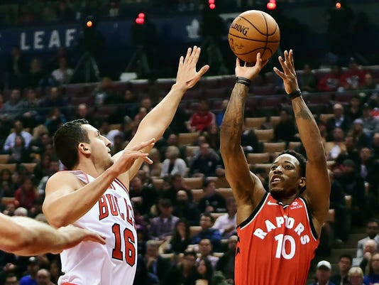 Toronto Raptors guard DeMar DeRozan (10) shoots over Chicago Bulls forward Paul Zipser (16) during the first half of an NBA basketball game, Tuesday, Nov. 7, 2017 in Toronto. (Frank Gunn/The Canadian Press via AP)