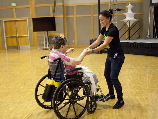 Dixie State students play bingo and dance with senior members of the community as part of the sweethearts dance Thursday, Feb. 12, 2015.