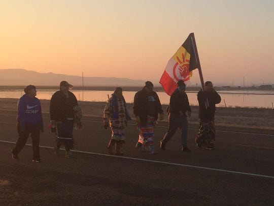 Dozens of people participate in a prayer walk Friday on the Fort Peck Reservation to bring awareness to the importance of water. They are concerned about the Keystone pipeline, which President Donald Trump permitted.