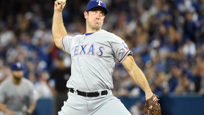 Texas Rangers relief pitcher Ross Ohlendorf throws a pitch against the Toronto Blue Jays in the 14th inning in game two of the ALDS at Rogers Centre in October.