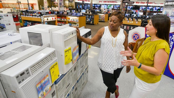 Savvy consumers consider energy savings when purchasing new appliances. Here, at P.C. Richard & Son on Route 59 in Nanuet, shoppers compare energy ratings on efficient refrigerators and air conditioning units.