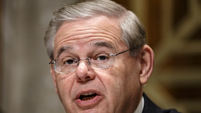 Senate Foreign Relations Chairman Robert Menendez, D-N.J., questions Secretary of State John Kerry on the status of diplomatic hot spots around the world, on Capitol Hill in Washington, Tuesday, April 8, 2014.