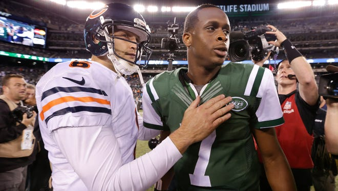 Bears quarterback Jay Cutler, left, greets Jets quarterback Geno Smith after the Bears beat the Jets 27-19 on Monday.