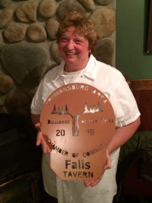 "Carol Van Derzee, accepted the award for The Falls Restaurant and Tavern, as ""Business of the Year,"" from the Trumansburg Area Chamber of Commerce at the organization's annual dinner last Friday night."