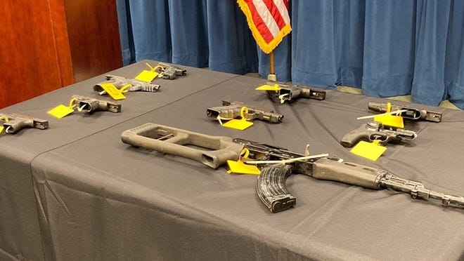 """U.S. Attorney Andrew Lelling said at least 25 firearms were seized during the investigation into the """"NOB"""" street gang in Boston, which began last summer and culminated Tuesday with 31 people facing federal charges. Lelling announced the charges during a press conference at U.S. District Court in Boston, Tuesday, June 16, 2020."""