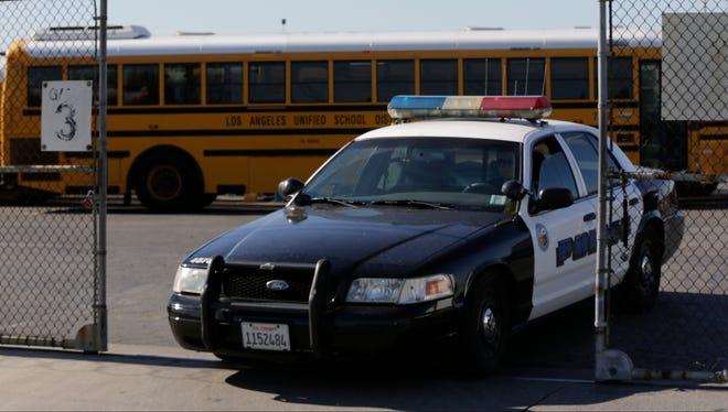 Los Angeles School District police patrols the district's bus garage in Gardena, Calif.,  Dec. 15, 2015.