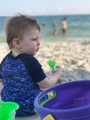 Ms. Cheap's grandson Beck Tefel enjoys playing in the sand on a family beach vacation.