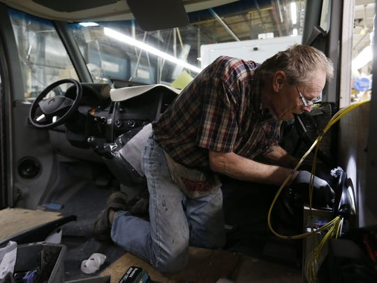 Larry Schuchhardt of Hayfield, Iowa, works on the wiring