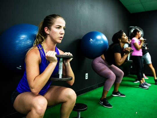 Sierra Sedwick does goblet squats during a HIIT Bootcamp