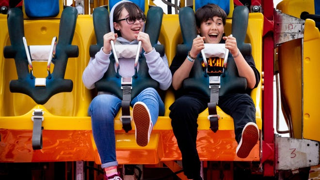 Skyy Stoddard, 12, left, from the Acreage, falls on the Mega Drop with her friend Ernesto Lujan, 13, of Wellington, at the South Florida Fair Friday in West Palm Beach on January 24, 2020.