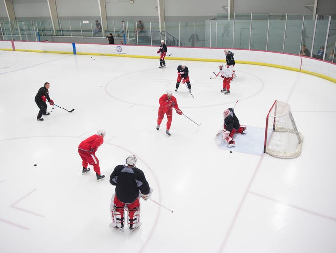 The Detroit Red Wings run through drills during practice