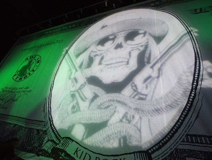A huge curtain with a gunslinging skeleton currency