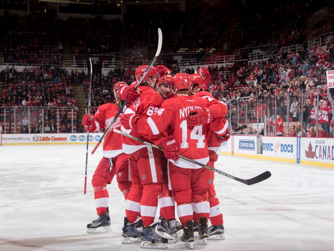 The Red Wings celebrate a goal by Danny DeKeyser in
