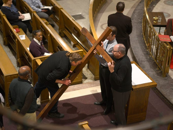 A parishioner kisses the cross during the veneration